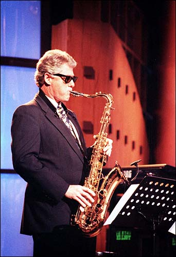 Bill Clinton playing the saxaphone