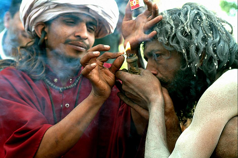 Indian smoking a chillum
